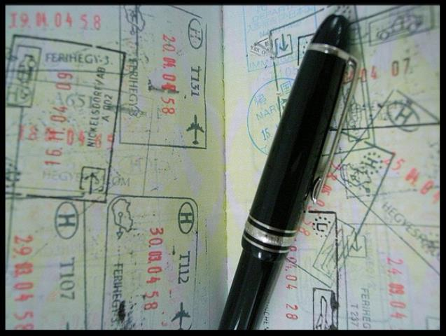 Passport and pen low res